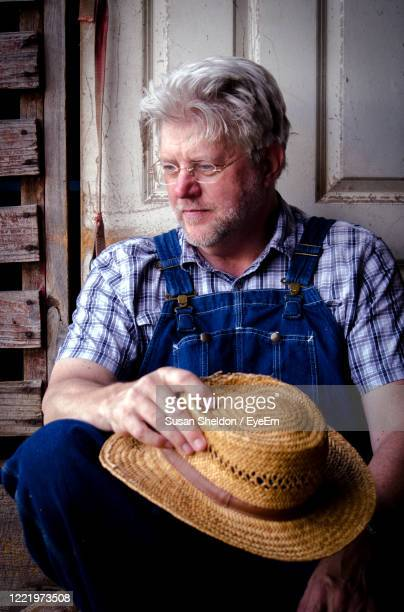portrait of a serious farmer taking a break after a tough day on the farm - feeding america stock pictures, royalty-free photos & images