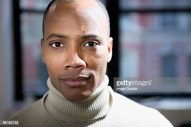 portrait of a serious looking man - turtleneck stock pictures, royalty-free photos & images