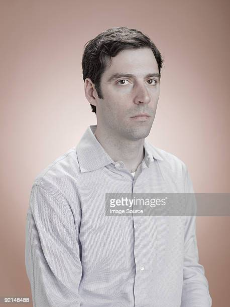 portrait of a serious looking man - blank expression stock pictures, royalty-free photos & images