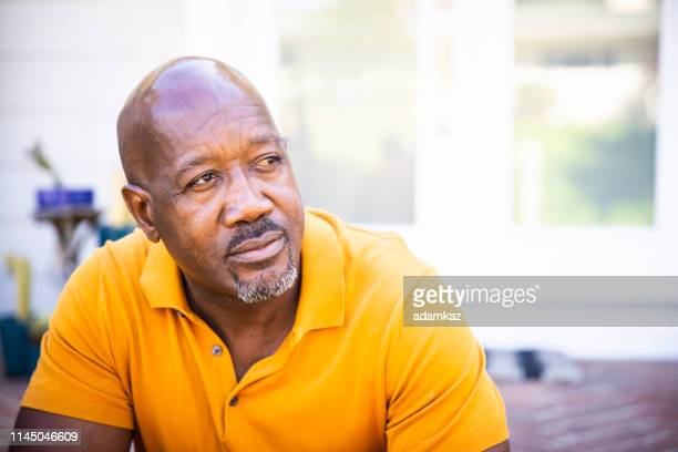 portrait of a serious mature black man - serious stock pictures, royalty-free photos & images