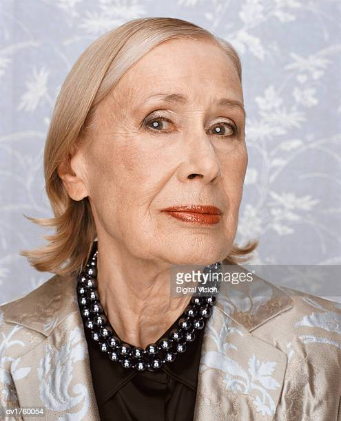 portrait of a serious senior woman - judgement stock pictures, royalty-free photos & images