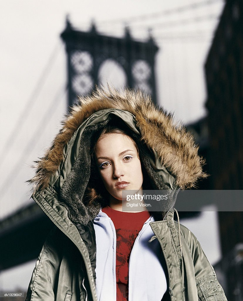 5db91b59dd25 Portrait Of A Serious Teenage Girl Wearing A Jacket With A Hood Up ...