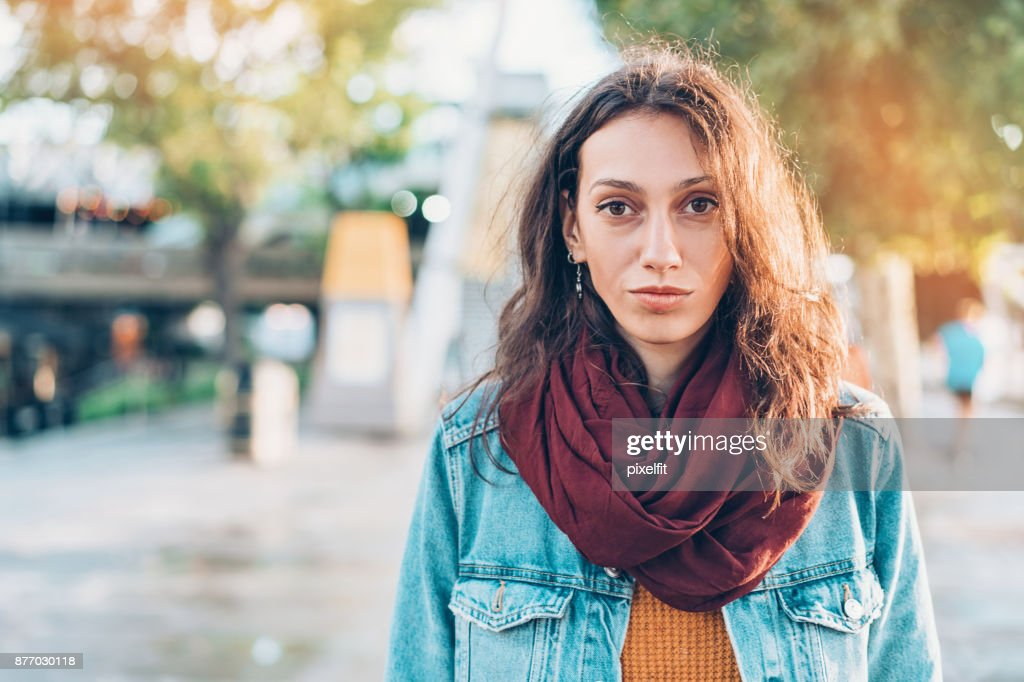 Portrait of a serious woman on the street : Stock Photo