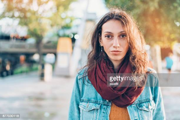 portrait of a serious woman on the street - serious stock pictures, royalty-free photos & images