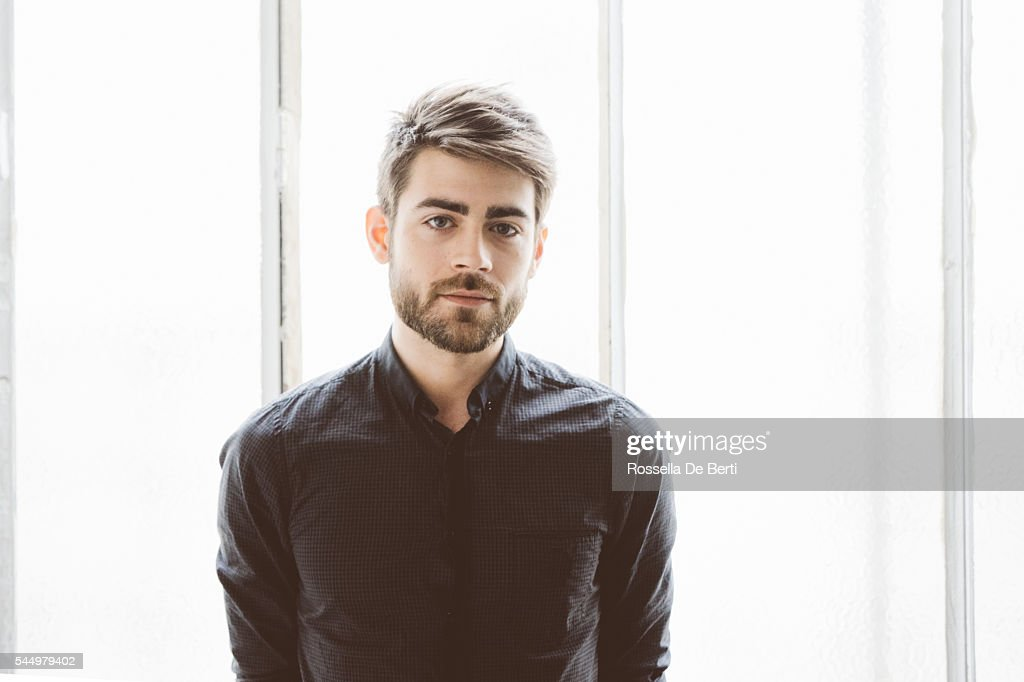 Portrait of a serious young man : Stock Photo
