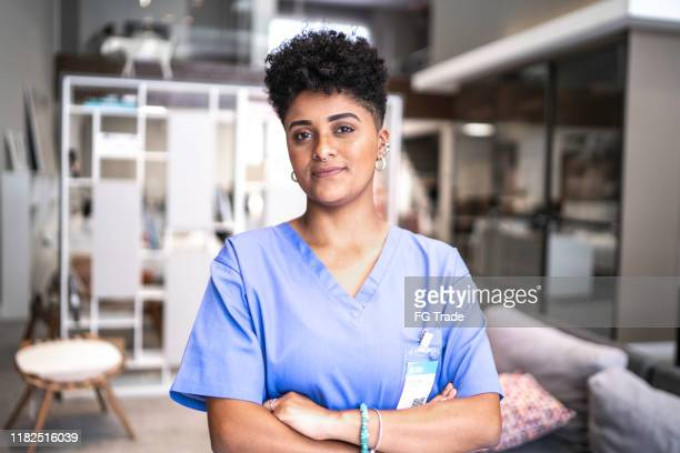portrait of a serious young nurse/doctor - female nurse stock pictures, royalty-free photos & images