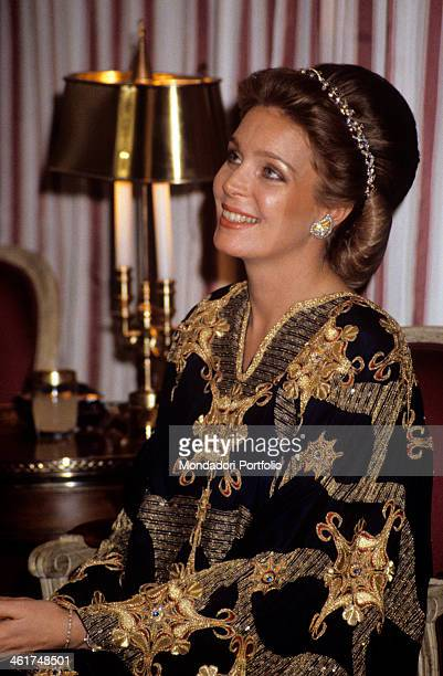 Portrait of a shining Queen Noor of Jordan seated on an armchair during a diplomatic meeting held at the royal palace between delegations of the...