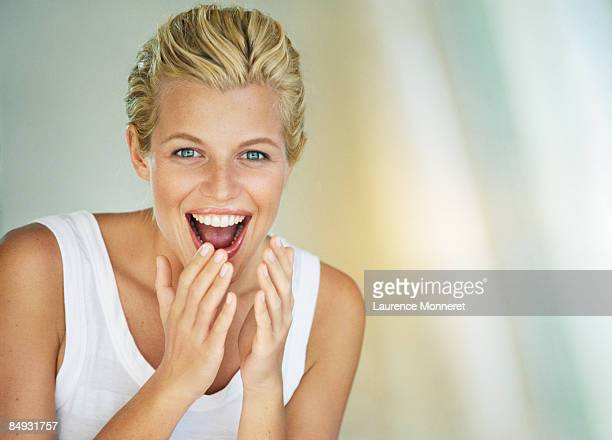 Portrait of a shocked and laughing young woman