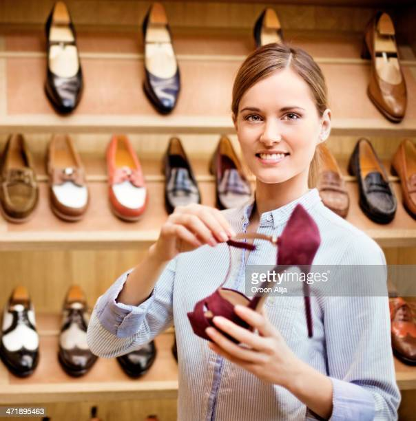 portrait of a shoe store owner - saleswoman stock photos and pictures
