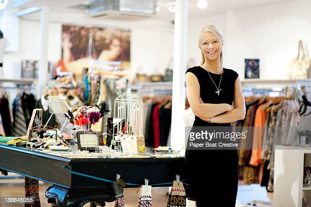 portrait of a shop owner standing proud - boutique stock photos and pictures