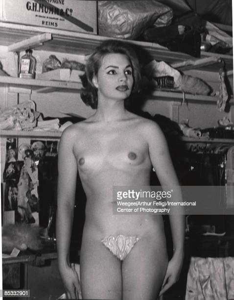 Portrait of a showgirl backstage naked from the waist up during a break in her performance New York ca1950s Photo by Weegee/International Center of...