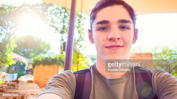 Portrait of a shy smiling young man