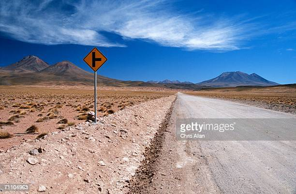 portrait of a sign post in the desert - world at your fingertips stock pictures, royalty-free photos & images