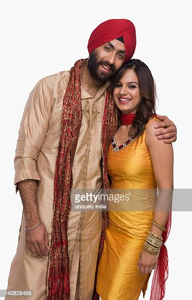 portrait of a sikh couple smiling - traditional clothing stock pictures, royalty-free photos & images