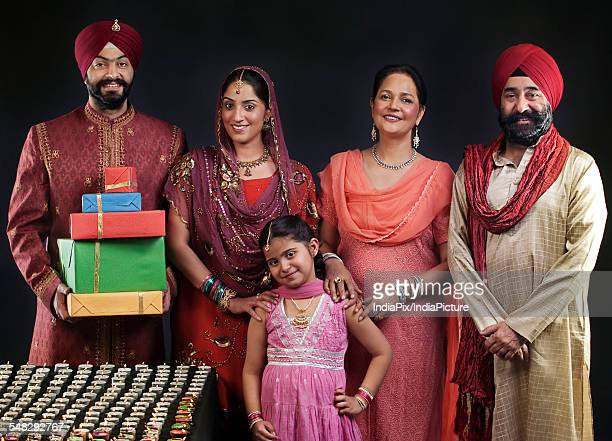 portrait of a sikh family with diyas - punjabi girls images stock photos and pictures
