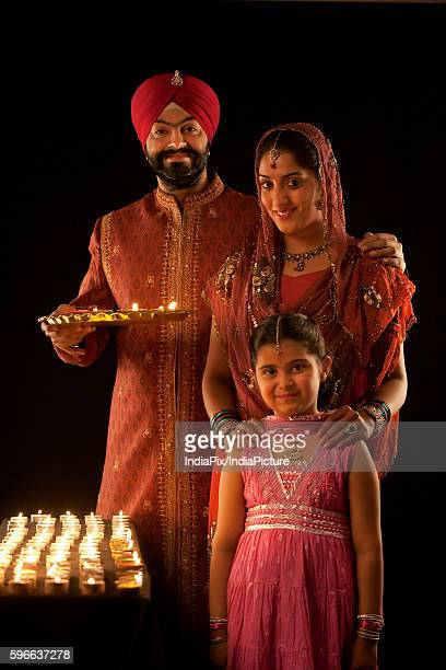 Portrait of a Sikh family with diyas