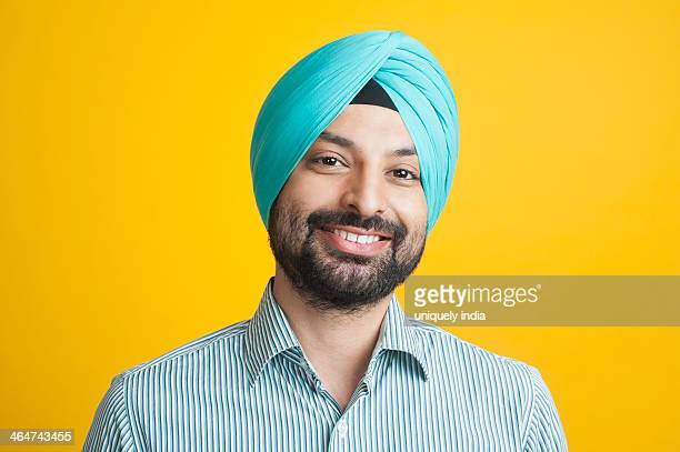 portrait of a sikh man smiling - sikh stock pictures, royalty-free photos & images