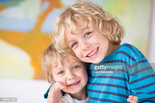 Portrait of a sixyearold boy with blond curls and his threeyearold little brothers on August 05 in Sankt Augustin Germany Photo by Ute...