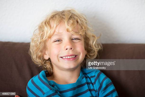 Portrait of a sixyearold boy with blond curls on August 05 in Sankt Augustin Germany Photo by Ute Grabowsky/Photothek via Getty Images