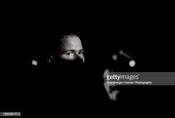 Portrait of a skinhead, his face partially hidden in shadow, at an unspecified club, Santa Clara, California, 1987.