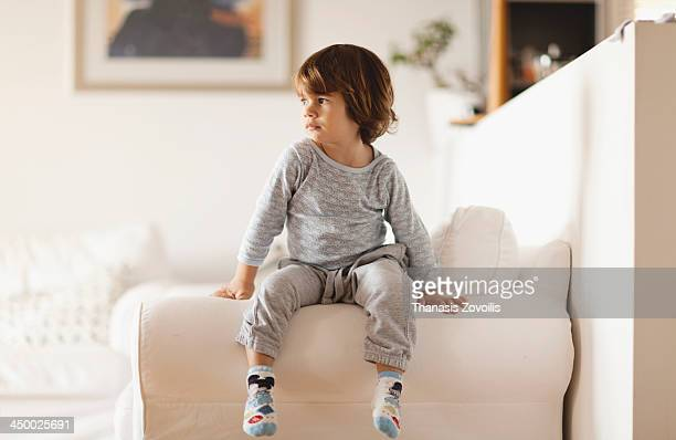 portrait of a small boy - sitzen stock-fotos und bilder