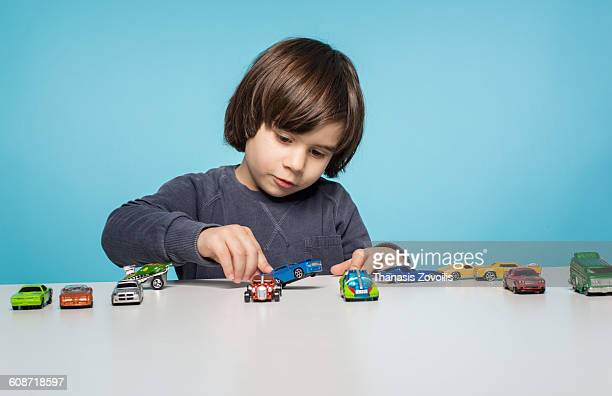 portrait of a small boy - toy car stock pictures, royalty-free photos & images