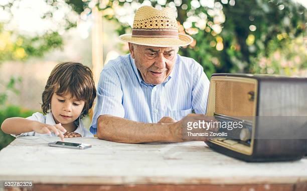 portrait of a small boy with his grandfather - rádio aparelhagem de áudio imagens e fotografias de stock