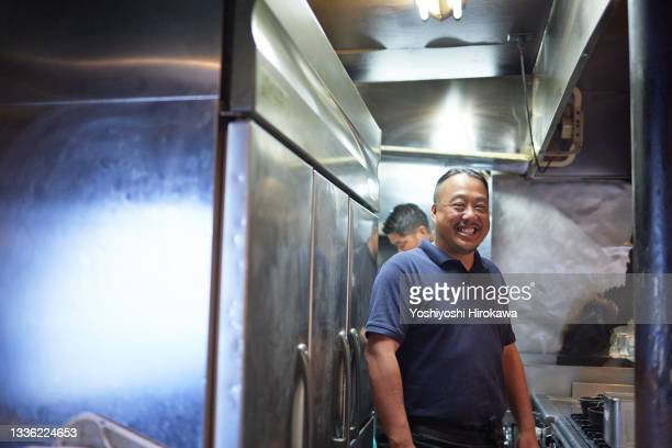 portrait of a small business owner - chigasaki stock pictures, royalty-free photos & images