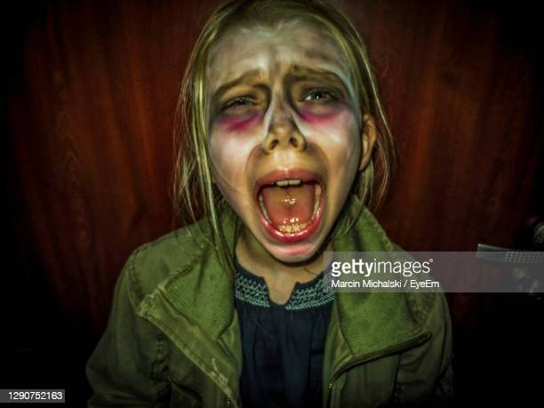 portrait of a small girl child with a halloween make  up she screaming. horror - paris fury stock pictures, royalty-free photos & images