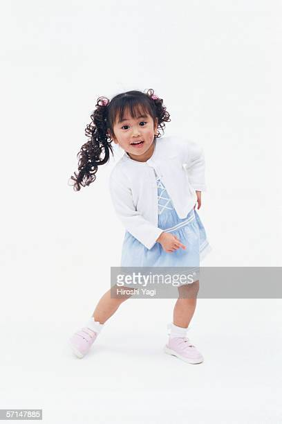 Portrait of a small girl with curly pigtails