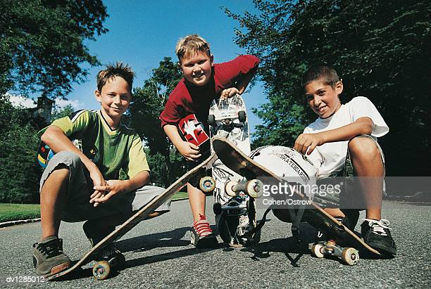Portrait of a Small Group of 10 to 13 Year Old Boy Skateboarders