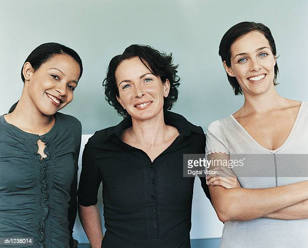 Portrait of a Small Group of Smiling Businesswomen