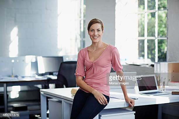 portrait of a smart businesswoman - pink pants stock pictures, royalty-free photos & images