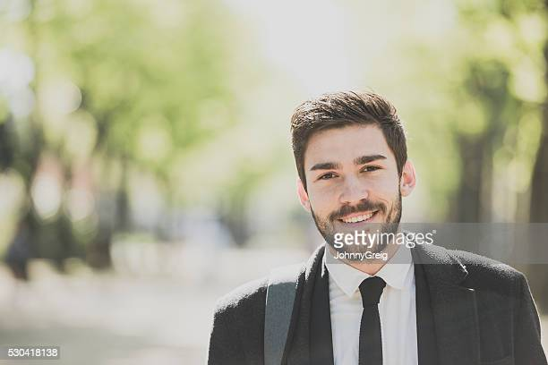 Portrait of a smart young man outdoors smiling