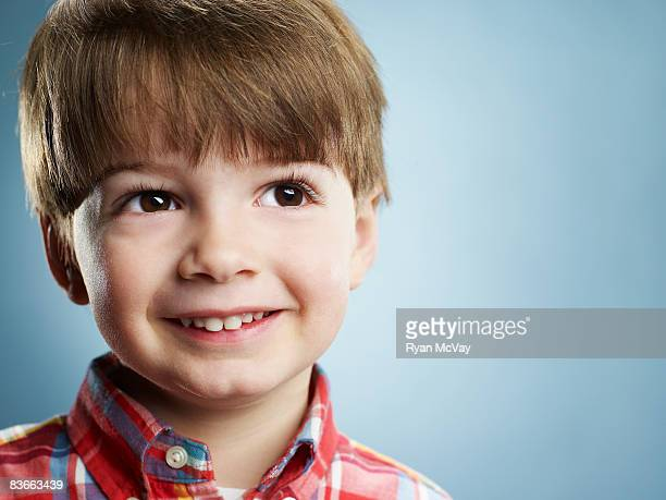 Portrait of a smiling 3 year old boy.