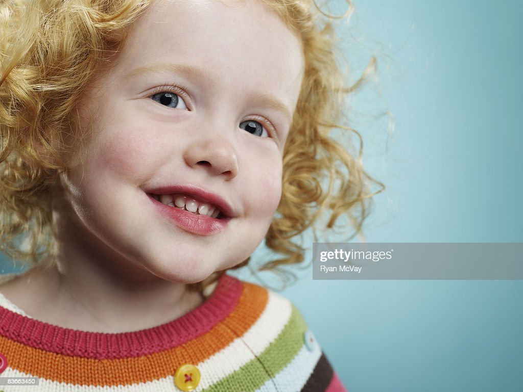 Portrait of a smiling 3 year old girl.  : Stock Photo