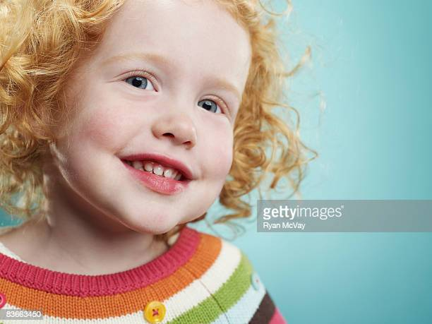 Portrait of a smiling 3 year old girl.