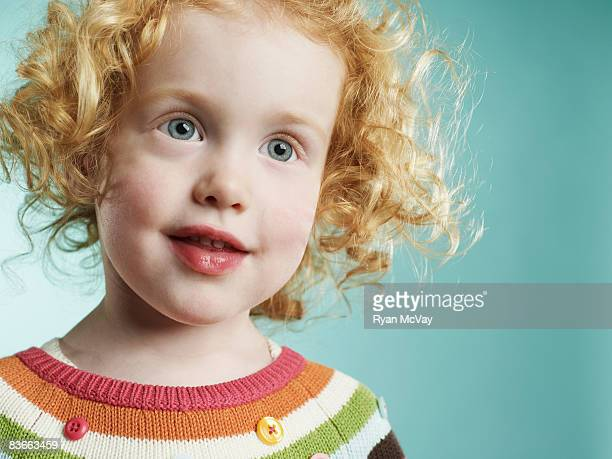 portrait of a smiling 3 year old girl. - gray eyes stock pictures, royalty-free photos & images
