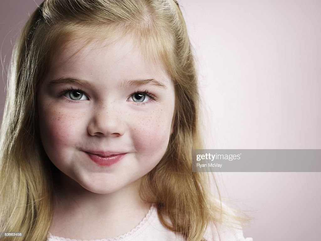 Portrait of a smiling 4 year old girl. : Stock Photo