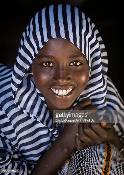 Portrait of a smiling afar tribe teenage girl afar region afambo Ethiopia on March 1 2016 in Afambo Ethiopia