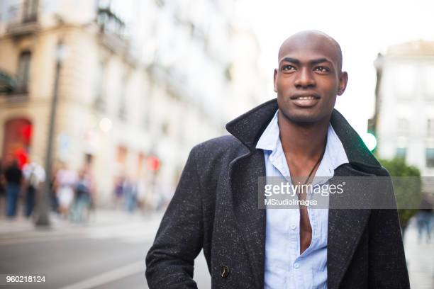 portrait of a smiling african man - nigerian men stock photos and pictures
