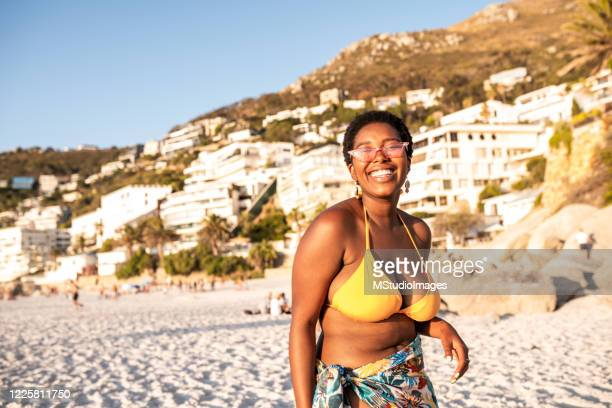 portrait of a smiling african woman - swimwear stock pictures, royalty-free photos & images