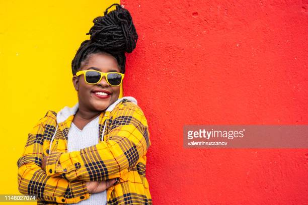 portrait of a smiling afro woman on colorful background - plus size model stock photos and pictures