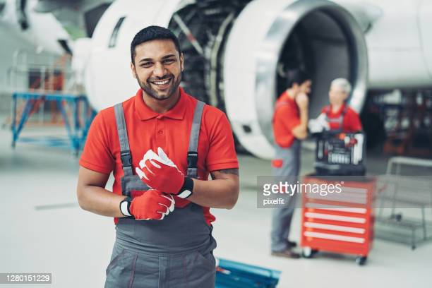 portrait of a smiling airplane technician - dungarees stock pictures, royalty-free photos & images