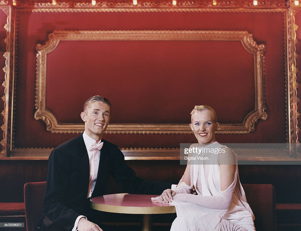 Portrait of a Smiling Ballroom Dancing Couple Sitting at a Table : Stock Photo