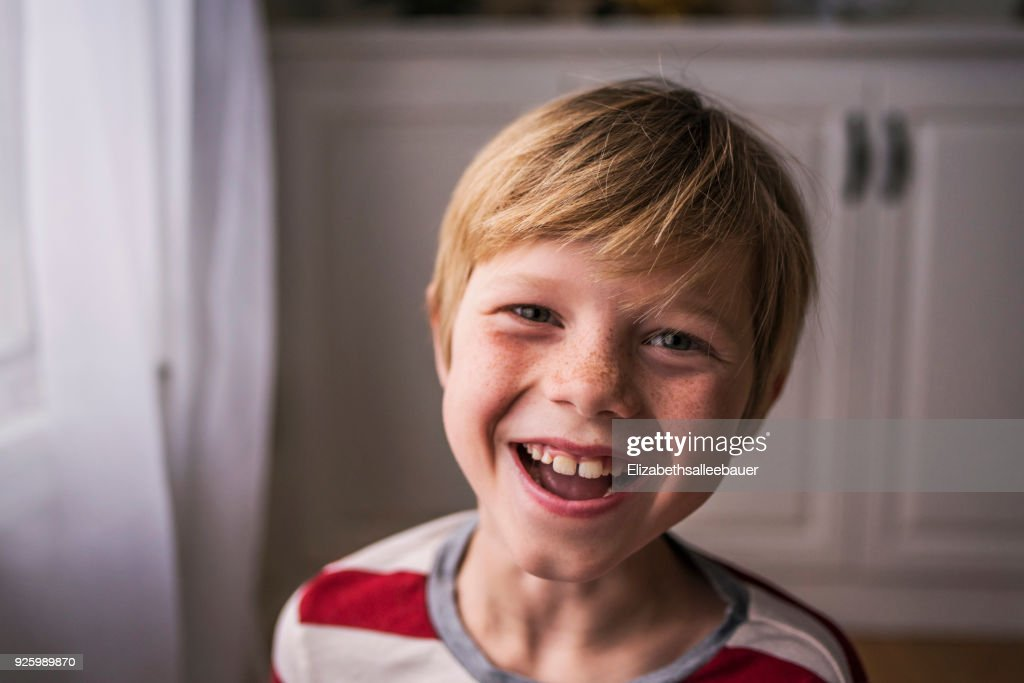 Portrait of a smiling boy with freckles : Stock Photo