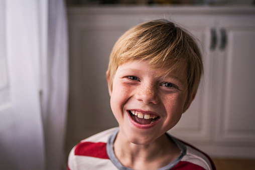 Portrait of a smiling boy with freckles - gettyimageskorea