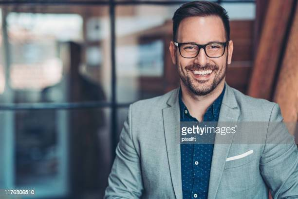 portrait of a smiling businessman - blazer jacket stock pictures, royalty-free photos & images