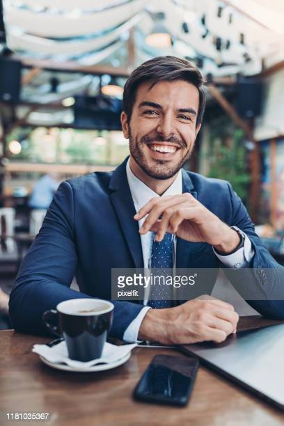 portrait of a smiling businessman - suave stock pictures, royalty-free photos & images