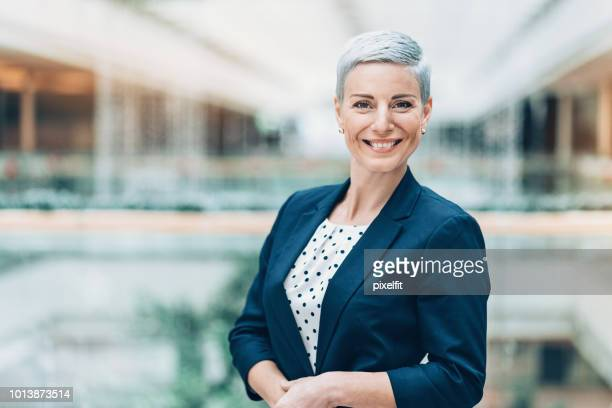 portrait of a smiling businesswoman - white hair stock pictures, royalty-free photos & images